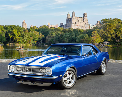AUT 22 RK3670 01 © Kimball Stock 1968 Chevrolet Camaro SS Blue And White 3/4 Front View On Pavement By Water And Castle
