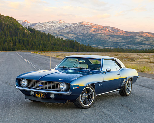 AUT 22 RK3673 01 © Kimball Stock 1969 Chevrolet Camaro Blue 3/4 Front View On Pavement By Lake On Hills
