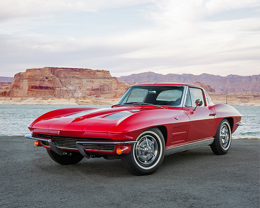AUT 22 RK3681 01 © Kimball Stock 1963 Chevrolet Corvette Sting Ray Split-Window Red 3/4 Front View On Pavement In Desert