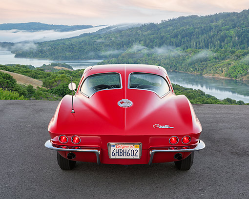 AUT 22 RK3683 01 © Kimball Stock 1963 Chevrolet Corvette Sting Ray Split-Window Red Rear View In Hills