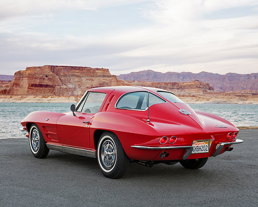 AUT 22 RK3684 01 © Kimball Stock 1963 Chevrolet Corvette Sting Ray Split Window Red 3/4 Rear View In Hills