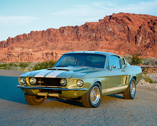 AUT 22 RK3687 01 © Kimball Stock 1967 Ford Mustang GT 350 Green And White 3/4 Front View In Desert