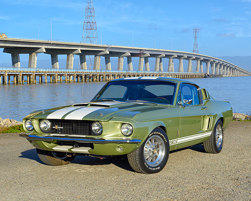 AUT 22 RK3689 01 © Kimball Stock 1969 Ford Mustang GT 350 Green And White 3/4 Front View By Water