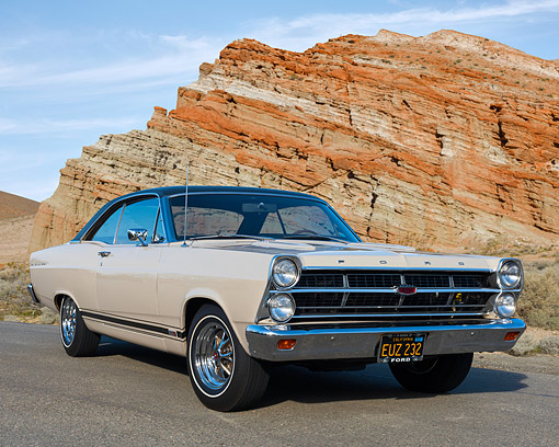 AUT 22 RK3693 01 © Kimball Stock 1967 Ford Fairlane GTA Beige 3/4 Front View In Desert