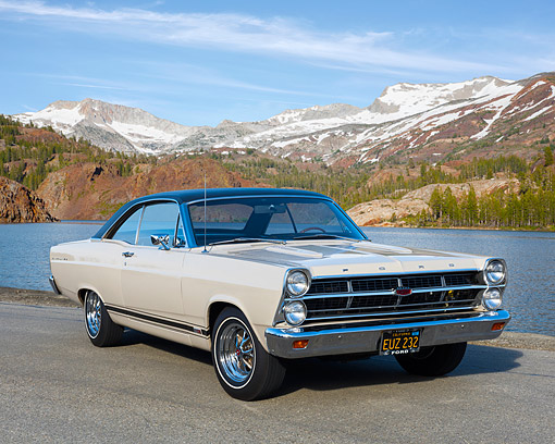 AUT 22 RK3694 01 © Kimball Stock 1967 Ford Fairlane GTA Beige 3/4 Front View On Pavement By Lake And Mountains