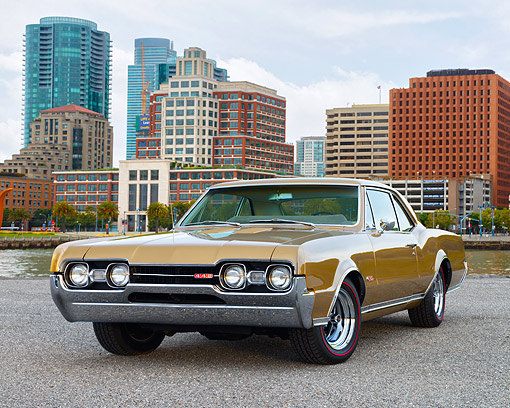AUT 22 RK3696 01 © Kimball Stock 1967 Oldsmobile 442 Cutlass Supreme Gold Low 3/4 Front View By City