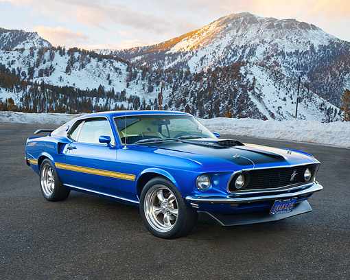 AUT 22 RK3699 01 © Kimball Stock 1969 Ford Mustang Mach 1 Cobra Jet Blue 3/4 Front View By Snowy Forest Mountains