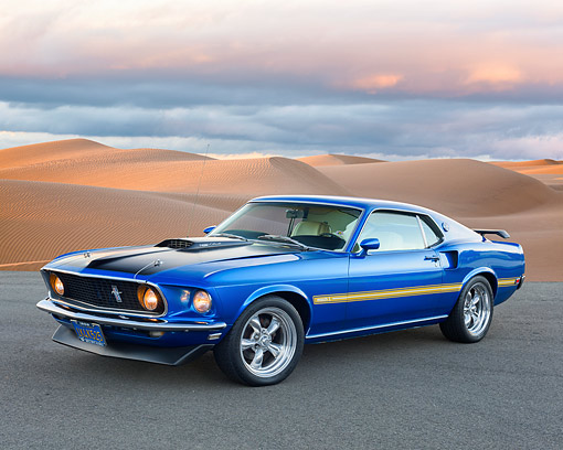 AUT 22 RK3700 01 © Kimball Stock 1969 Ford Mustang Mach 1 Cobra Jet Blue 3/4 Front View By Sandy Windy Desert Dunes