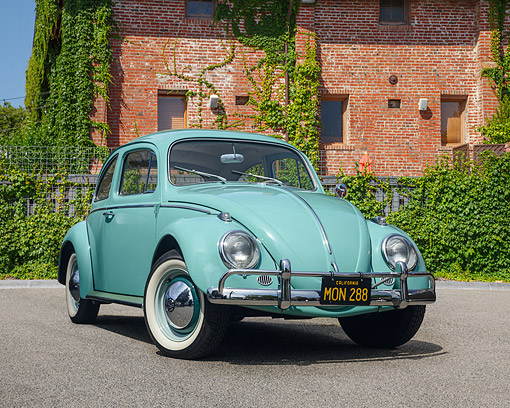 AUT 22 RK3741 01 © Kimball Stock 1963 Volkswagen Beetle Turkish Turquoise 3/4 Front View By Brick Building