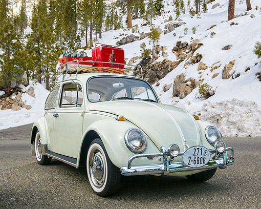AUT 22 RK3747 01 © Kimball Stock 1966 Volkswagen Beetle Square Window Beige 3/4 Front View On Snowy Mountain Road