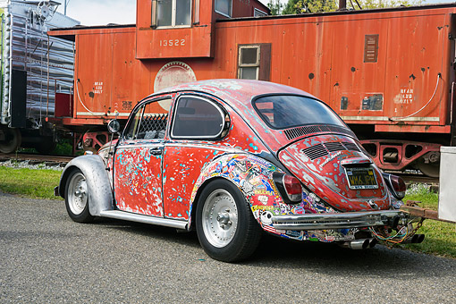 AUT 22 RK3758 01 © Kimball Stock 1969 Volkswagen Beetle Jawbreaker Color 3/4 Front View By Train