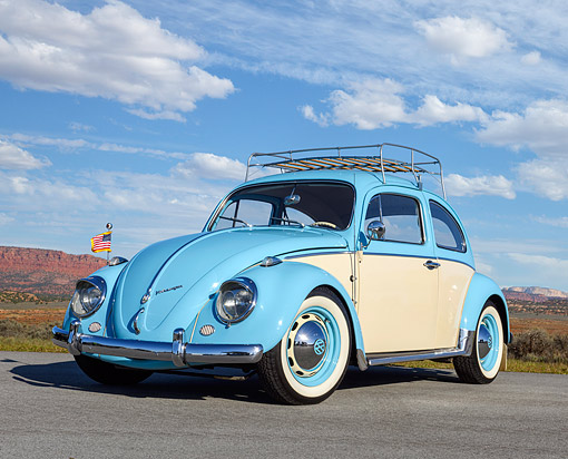 AUT 22 RK3763 01 © Kimball Stock 1961 Volkswagen Beetle Blue And Cream With Rack 3/4 Front View In Desert