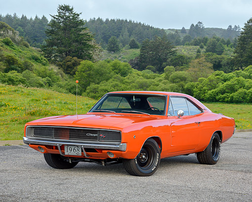 AUT 22 RK3771 01 © Kimball Stock 1968 Dodge Charger R/T Orange 3/4 Front View On Pavement By Trees And Hills
