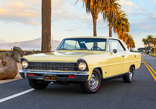 AUT 22 RK3788 01 © Kimball Stock 1967 Chevrolet Nova SS Super Sport Butternut Yellow 3/4 Front View On Road By Beach
