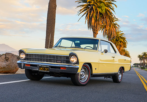 AUT 22 RK3789 01 © Kimball Stock 1967 Chevrolet Nova SS Super Sport Butternut Yellow 3/4 Front View On Road By Beach