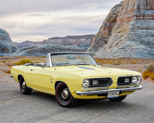 AUT 22 RK3798 01 © Kimball Stock 1968 Plymouth Barracuda Forumula S 340 Convertible Yellow 3/4 Front View On Road In Desert