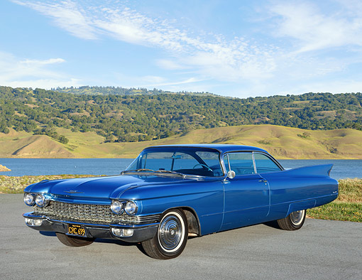 AUT 22 RK3800 01 © Kimball Stock 1960 Cadillac Coupe DeVille Blue 3/4 Front View By Lake And Mountais