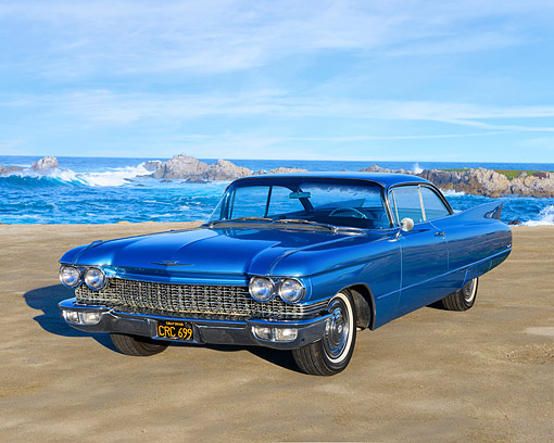 AUT 22 RK3801 01 © Kimball Stock 1960 Cadillac Coupe DeVille Blue 3/4 Front View By Ocean