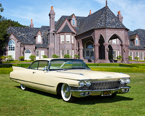 AUT 22 RK3804 01 © Kimball Stock 1960 Cadillac Coupe De Ville Beige 3/4 Front View On Grass By Mansion
