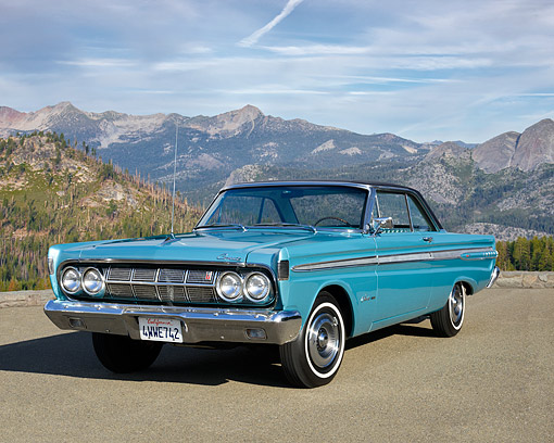AUT 22 RK3822 01 © Kimball Stock 1964 Mercury Comet Light Blue 3/4 Front View By Mountains
