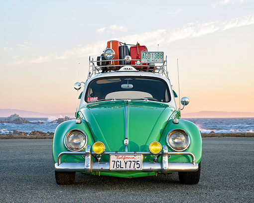 AUT 22 RK3824 01 © Kimball Stock 1963 Volkswagon Beetle Taxi Green And White Front View By Ocean