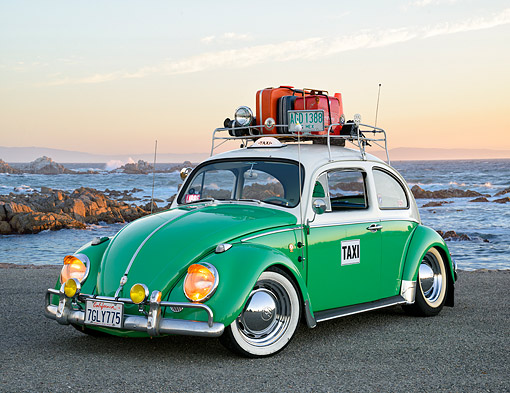 AUT 22 RK3826 01 © Kimball Stock 1963 Volkswagon Beetle Taxi Green And White 3/4 Front View By Ocean