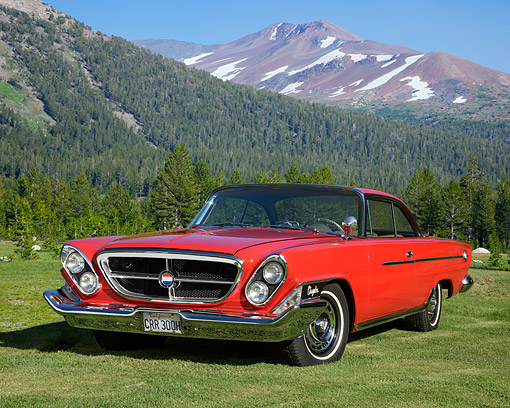 AUT 22 RK3831 01 © Kimball Stock 1962 Chrysler 300H Red 3/4 Front View By Trees And Mountains