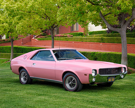 AUT 22 RK3832 01 © Kimball Stock 1968 American Motors AMX Playmate Pink 3/4 Front View By Trees