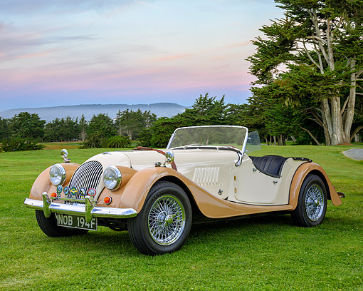 AUT 22 RK3833 01 © Kimball Stock 1968 Morgan Plus 4 Roadster Cream And Beige 3/4 Front View On Golf Course Under Sunset