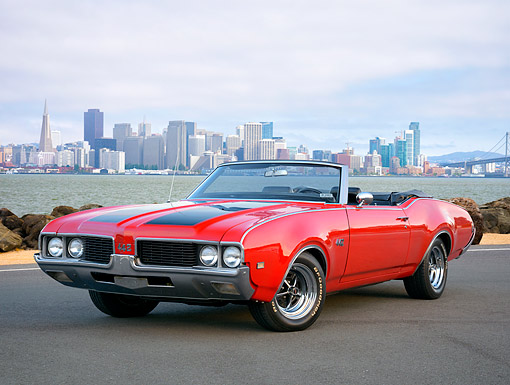 AUT 22 RK3849 01 © Kimball Stock 1969 Oldsmobile 442 Convertible Red 3/4 Front View By Bay And City