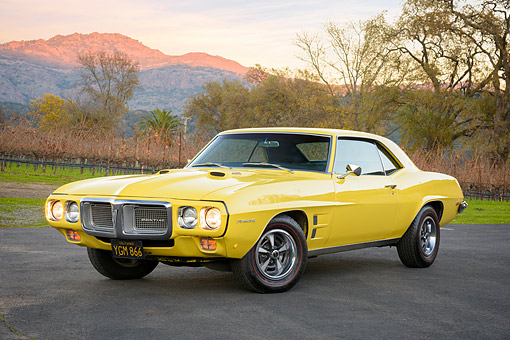 AUT 22 RK3854 01 © Kimball Stock 1969 Pontiac Firebird 400 H.O. Yellow 3/4 Front View By Hills