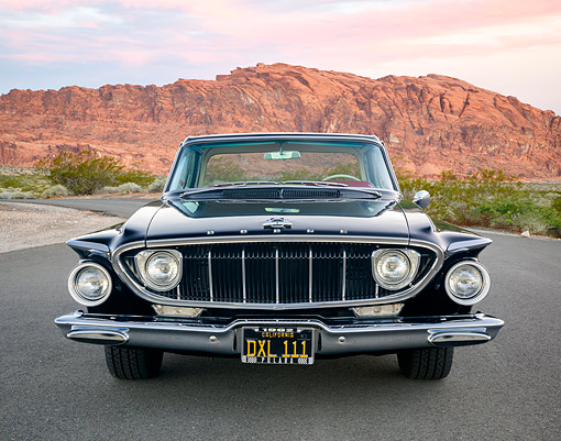 AUT 22 RK3858 01 © Kimball Stock 1962 Dodge Polara 500 2-Door Hardtop Black Front View In Desert