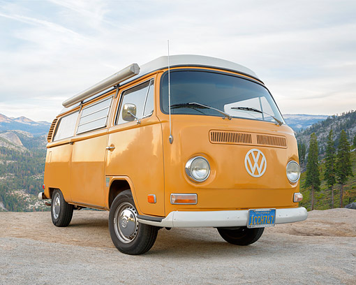 AUT 22 RK3875 01 © Kimball Stock 1972 Volkswagen Bus Camper Orange 3/4 Front View By Trees And Mountains