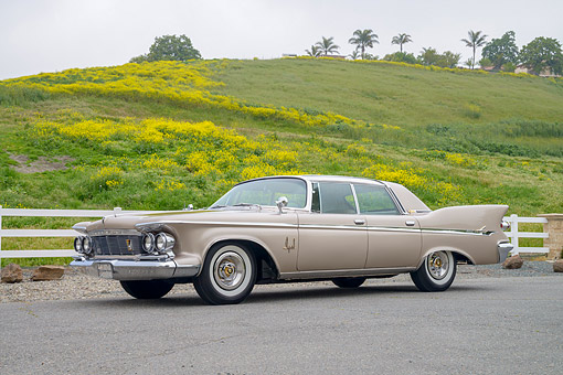 AUT 22 RK3881 01 © Kimball Stock 1961 Imperial LeBaron Beige 3/4 Front View By Hills