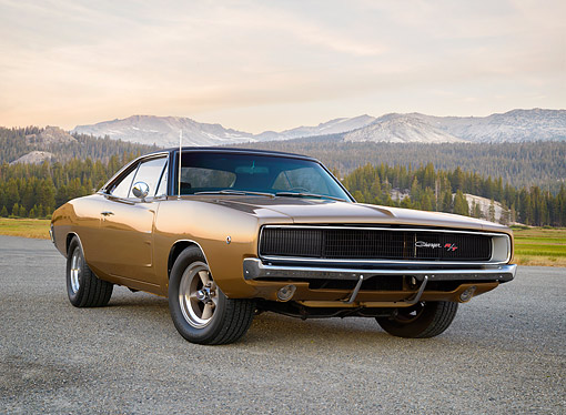 AUT 22 RK3884 01 © Kimball Stock 1968 Dodge Charger R/T 440 Gold 3/4 Front View On Pavement By Forest And Mountains