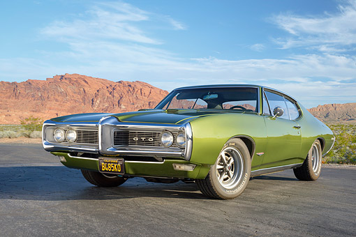 AUT 22 RK3885 01 © Kimball Stock 1968 Pontiac GTO Green Low 3/4 Front View On Pavement In Desert