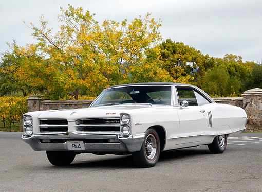 AUT 22 RK3888 01 © Kimball Stock 1966 Pontiac 2+2 421 White 3/4 Front View Under Gray Skies And Autumn Trees