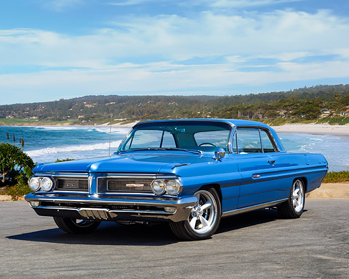 AUT 22 RK3891 01 © Kimball Stock 1962 Pontiac Grand Prix Blue 3/4 Front View By Ocean