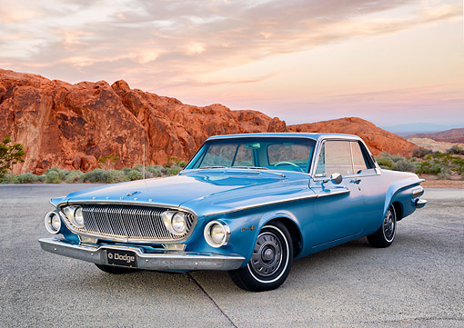 AUT 22 RK3892 01 © Kimball Stock 1962 Dodge Dart 440 Blue 3/4 Front View In Desert
