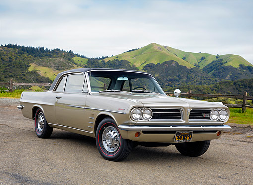 AUT 22 RK3893 01 © Kimball Stock 1963 Pontiac Lemans V326 Gold 3/4 Front View By Hills