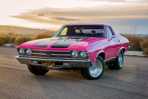 AUT 22 RK3898 01 © Kimball Stock 1969 Chevrolet Chevelle SS 454 Pink 3/4 Front View On Road At Sunset