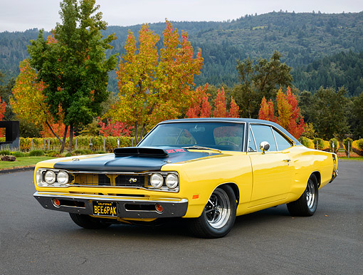 AUT 22 RK3899 01 © Kimball Stock 1969 Dodge Super Bee 440 Six Pack Yellow 3/4 Front View By Autumn Trees