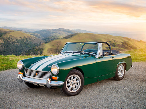 AUT 22 RK3901 01 © Kimball Stock 1969 Austin-Healey Mark IV Sprite Convertible Green 3/4 Front View By Hills At Sunset
