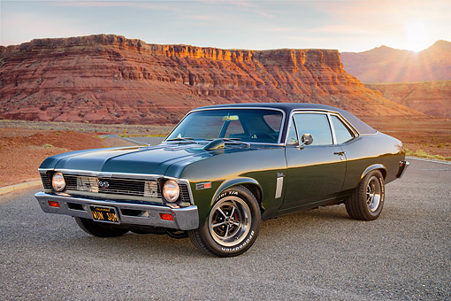 AUT 22 RK3903 01 © Kimball Stock 1969 Chevrolet Nova SS 427 Green 3/4 Front On Desert Road At Sunset