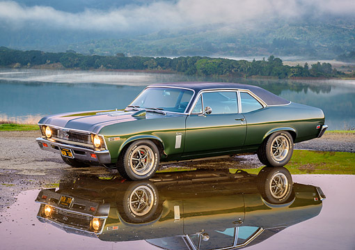AUT 22 RK3904 01 © Kimball Stock 1969 Chevrolet Nova SS 427 Green 3/4 Front View Reflecting In Water Puddle With Lake In Background