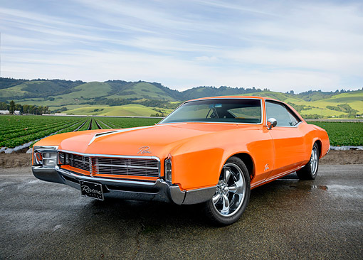 AUT 22 RK3918 01 © Kimball Stock 1967 Buick Riviera Orange 3/4 Front View On By Farm