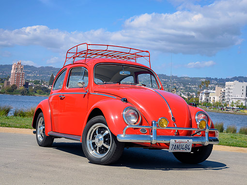 AUT 22 RK3919 01 © Kimball Stock 1963 Volkswagen Beetle Red 3/4 Front View By Water And Buildings