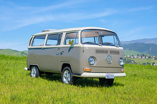 AUT 22 RK3922 01 © Kimball Stock 1969 Volkswagen Camper Bus Gray 3/4 Front View On Grass By Hills