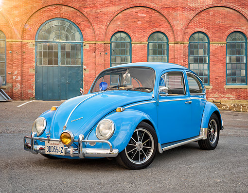 AUT 22 RK3924 01 © Kimball Stock 1963 Volkswagen Bug Blue 3/4 Front View On Pavement By Brick Building