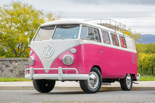 AUT 22 RK3925 01 © Kimball Stock 1966 Volkswagen Bus Pink 3/4 Front View On Pavement By Trees